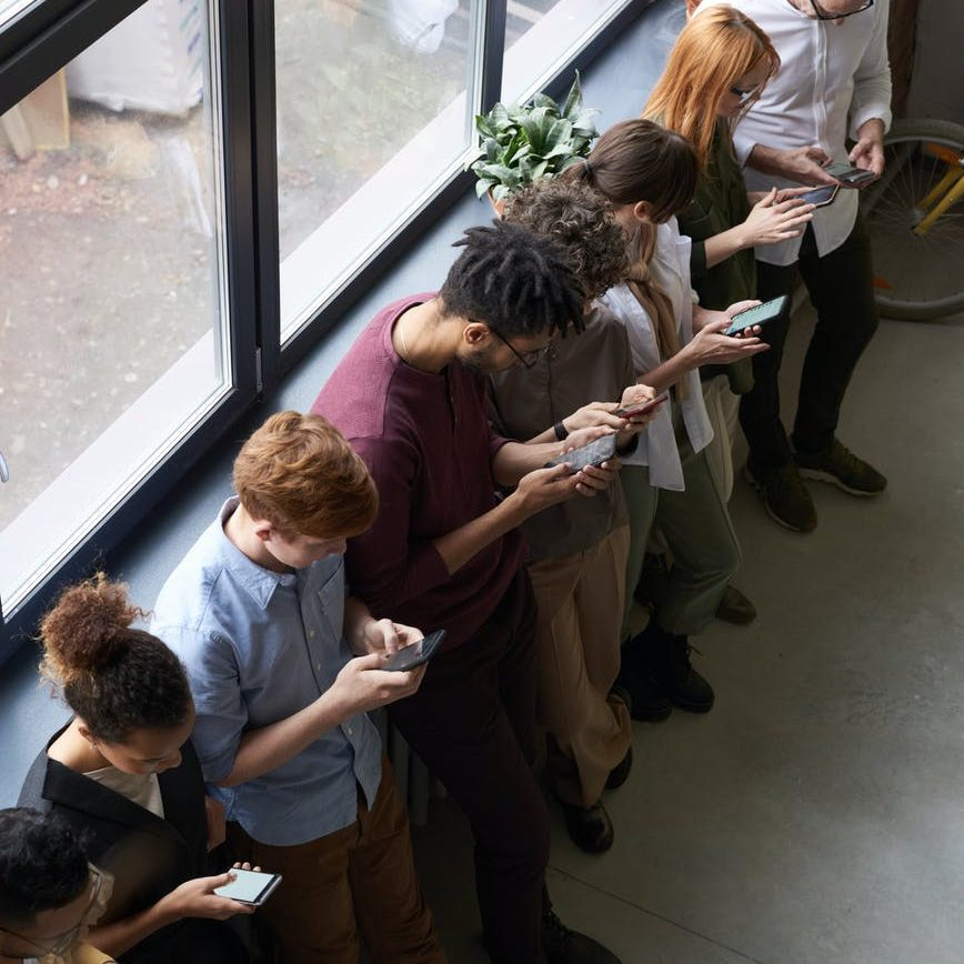 people holding their phones